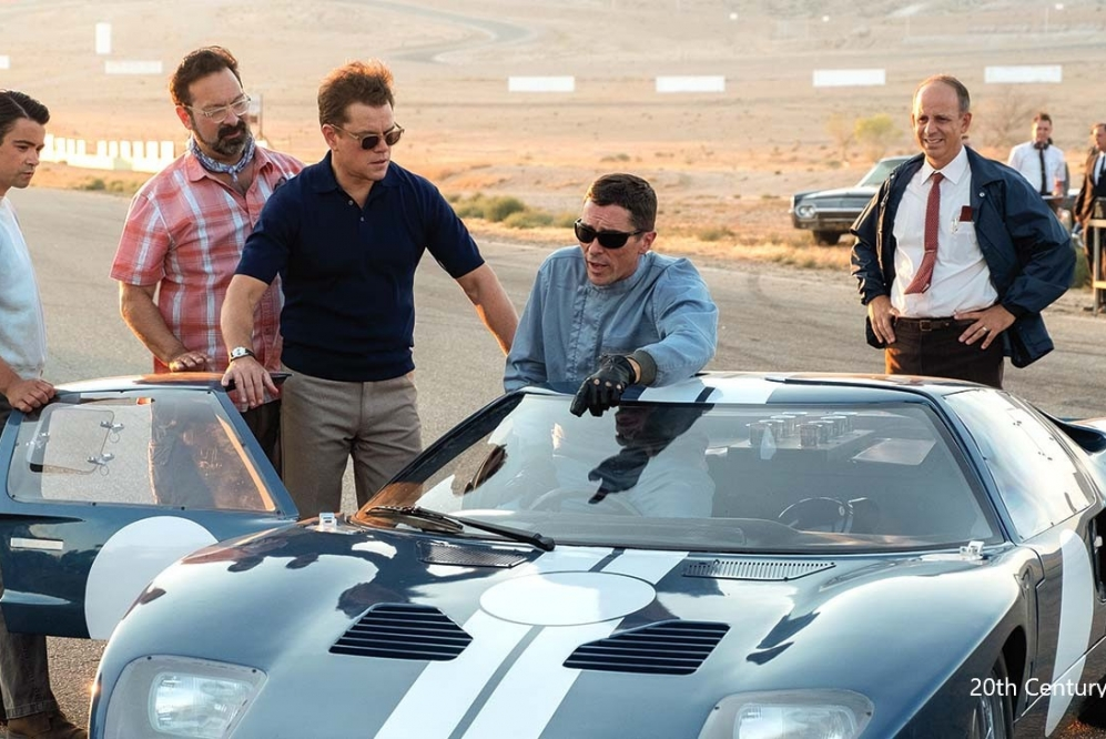 Photo of crew and cast of Ford vs. Ferrari looking at the Ford GT.