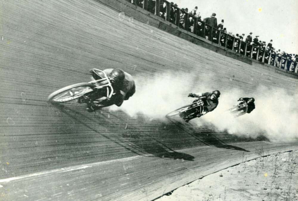 Photo of motorcycle board track racing. Throttlestop's Motorcycle Museum has real and replicas of motorcycles from this era.