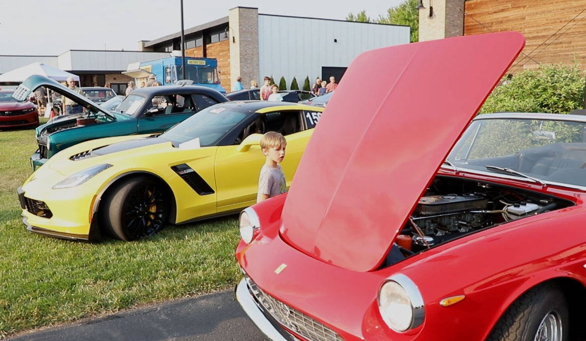 Young child looking at classic car at Throttlestop